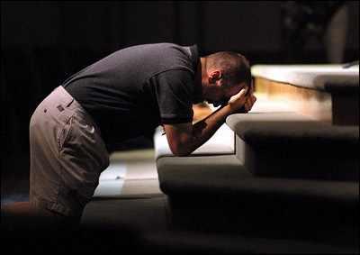 man praying at alter